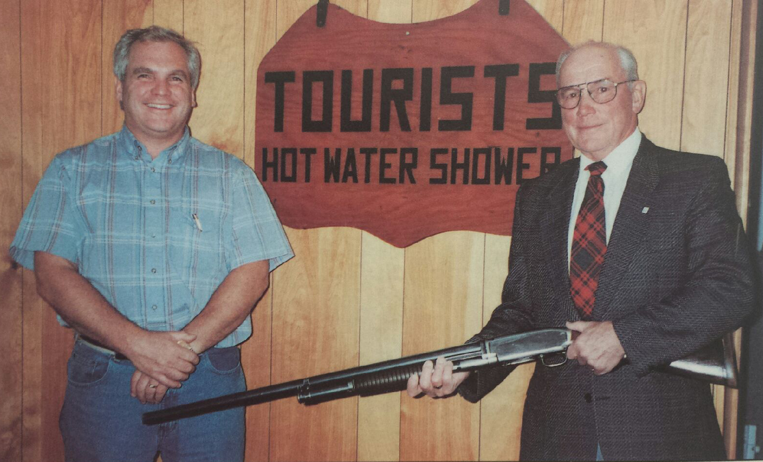 Allan (left) and Laurie holding his favourite hunting gun, received in exchange for making a leg. Tourist sign, which hung outside the family homestead, to accommodate patients due to the distance they travelled and the time required to manufacture their limbs.